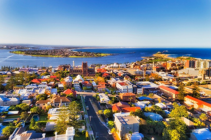 City of Newcastle in Australia north from Sydney - Hunter river mouth to Pacific ocean. CBD of industrial hub and sea port with local streets and houses around the Cathedral of Newcastle.; Shutterstock ID 1130932769; Country: Australia; Business Line: Research; Cost Centre: A2140