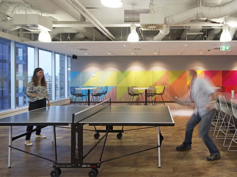 employees playing table tennis